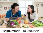 young asian couple preparing... | Shutterstock . vector #1033081945