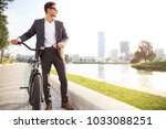 businessman riding bicycle to... | Shutterstock . vector #1033088251