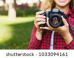 young female student taking... | Shutterstock . vector #1033094161