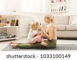 happy mother and little... | Shutterstock . vector #1033100149