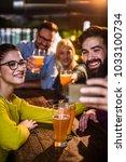 friends in pub drinking beer... | Shutterstock . vector #1033100734