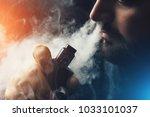 man vape e cigarette with e... | Shutterstock . vector #1033101037