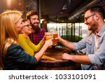 group of young friends in bar... | Shutterstock . vector #1033101091