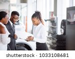 smiling african couple buying... | Shutterstock . vector #1033108681