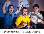 soccer or football fans... | Shutterstock . vector #1033109041