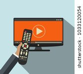 hand holding remote control. tv ... | Shutterstock .eps vector #1033120054
