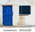 Old House Wall With Blue Door...