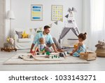 family father and children play ... | Shutterstock . vector #1033143271