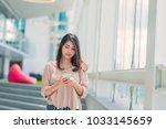 happy beautiful asian woman... | Shutterstock . vector #1033145659