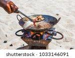 cooking sea food on beach....   Shutterstock . vector #1033146091