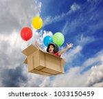 kid fly with baloon | Shutterstock . vector #1033150459