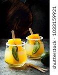 spicy mango popsicle margarita... | Shutterstock . vector #1033159921