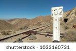 Milepost Alongside The Tracks
