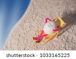 happy egg lying on a deck chair ... | Shutterstock . vector #1033165225