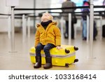 cute little boy with big yellow ... | Shutterstock . vector #1033168414