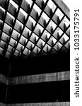 Small photo of A building roof shaped into diamond shapes causing different lines and shades in dark black and white
