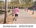 the old man jogging run on the...   Shutterstock . vector #1033191634
