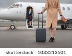 female going to airplane while... | Shutterstock . vector #1033213501