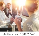 business woman conducts a... | Shutterstock . vector #1033216621