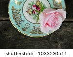 Small photo of Tea Cups and Roses. An elegant composition against a rustic wood background, with a hint of autumn. This eloquent still life depicts beauty and life.