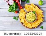 guacamole avocado  lime  tomato ... | Shutterstock . vector #1033243324