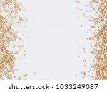 grain of real quinoa isolated... | Shutterstock . vector #1033249087