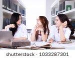 portrait of three female... | Shutterstock . vector #1033287301