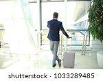 businessman speaking on the... | Shutterstock . vector #1033289485