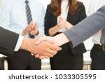 businesswoman and businessman... | Shutterstock . vector #1033305595