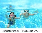 Children Swim In Swimming Pool...
