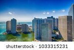 downtown miami and brickell key ... | Shutterstock . vector #1033315231