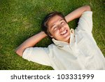 smiling man lying with both... | Shutterstock . vector #103331999