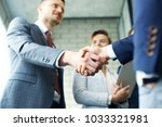 business people shaking hands ... | Shutterstock . vector #1033321981