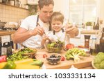 father is cooking with his son   Shutterstock . vector #1033331134