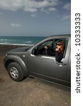 woman and her 4wd car at beach   Shutterstock . vector #10333333