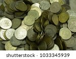 A Pile Of Old Coins From...