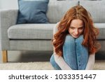 young redhead woman sitting on... | Shutterstock . vector #1033351447