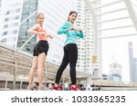 sportswomen stretching after... | Shutterstock . vector #1033365235