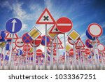 many road signs against blue... | Shutterstock . vector #1033367251