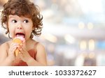 ice cream eating by kid | Shutterstock . vector #1033372627