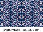 ikat geometric folklore... | Shutterstock .eps vector #1033377184