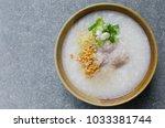 asian rice porridge with... | Shutterstock . vector #1033381744