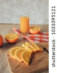 oranges on a cutting board and... | Shutterstock . vector #1033395121
