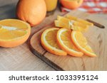 oranges on a cutting board and... | Shutterstock . vector #1033395124