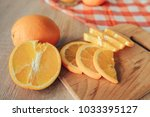 oranges on a cutting board and... | Shutterstock . vector #1033395127
