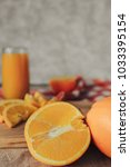 oranges on a cutting board and... | Shutterstock . vector #1033395154