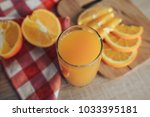 oranges on a cutting board and... | Shutterstock . vector #1033395181