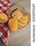 oranges on a cutting board and... | Shutterstock . vector #1033395187