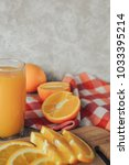 oranges on a cutting board and... | Shutterstock . vector #1033395214
