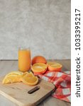oranges on a cutting board and... | Shutterstock . vector #1033395217